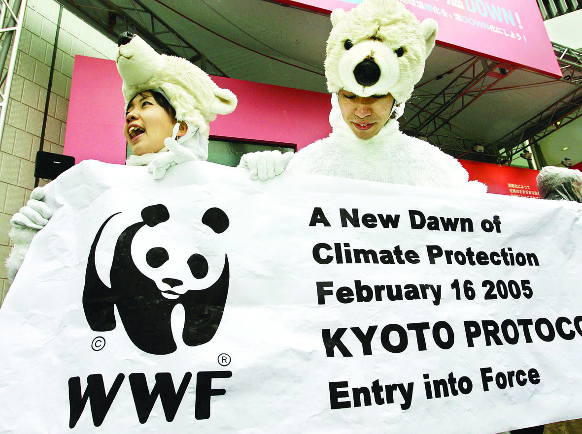 Activists clad in polar bear outfits hold a banner in the Ginza shopping district of Tokyo, 16 February 2005, to celebrate the Kyoto Protocol. The landmark treaty requiring cuts in gas emissions causing global warming took effect 16 February with support of 141 nations. AFP PHOTO/Toru YAMANAKA / AFP PHOTO / TORU YAMANAKA